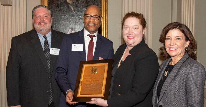 UB LAA President-Elect Marc Brown '99 and Vice Dean for Academic Affairs Todd Brown present the Jaeckle Award to recipient Hon. Barbara Howe '80 at the 2018 NYC Alumni Luncheon.