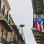 Puerto Rican flag hanging from a balcony in Old San Juan, Puerto Rico.