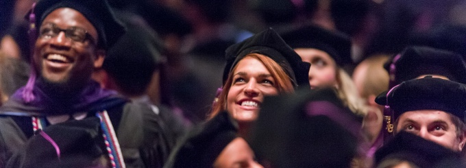 Graduating student from law school with graduation caps and gowns.