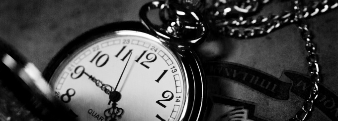 Black and white photo of a pocket watch.