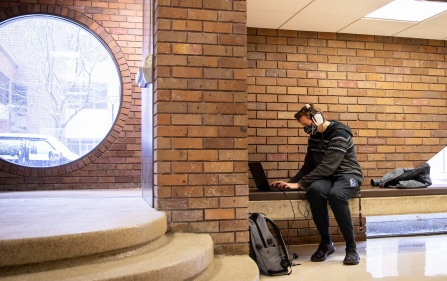 law students typing on laptop inside O'Brien Hall.