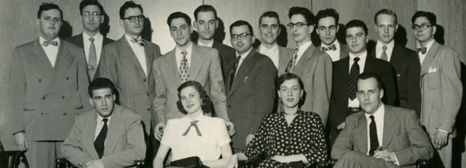 This is a group photo of the first Buffalo Law Review editorial board (1951-52). The Law Review's inaugural issue was published by a group of law students under the guidance of Professor Charles W. Webster. The issue was 350 pages and had an initial run of 100 copies without having any subscribers. The lead article in Volume 1 was written by Charles S. Desmond who was then an Associate Judge on the New York Court of Appeals and would later become the Chief Judge of New York's highest court.