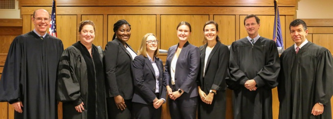Judges and finalists at the 2018 Charles S. Desmond Moot Court Competition (left to right): Hon. Eugene M. Fahey '88, Dean Aviva Abramovsky, Destiny M. Johnson '20, Chloe J. Nowak '20, Hannah Rauh '20, Meghan M. Carrig '20, Hon. Jeremiah J. McCarthy and Hon. Emilio Colaiacovo '01.