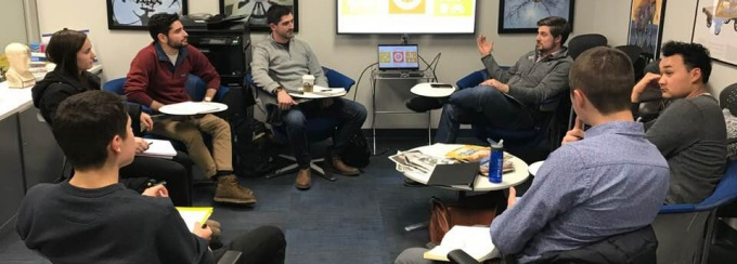 Pelkey with law students from the Entrepreneurship Law Center meeting with UB's Blackstone LaunchPad to help them prepare their pitches for the World's Challenge Challenge, a program that calls on students to solve some of the problems facing the world.