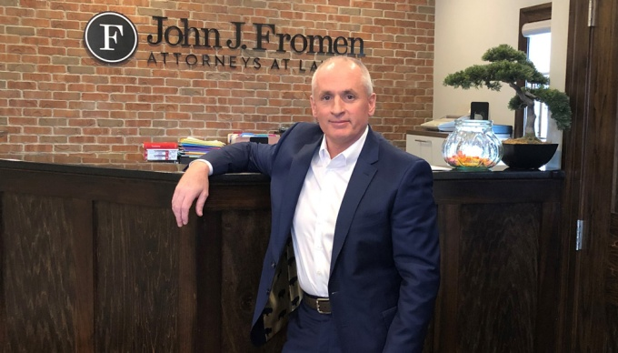 John J. Fromen Jr. '87 in front of the reception desk at his practice.