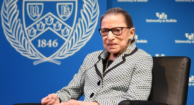 photo of Ginsburg sitting on stage.