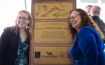 Photo of Bridget Steele and Kim Connolly posing with designation plaque.