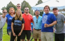 photo of law faculty and students attending a tailgate party.