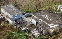Photo by Kris Grogan, U.S. Customs Border Patrol. While conducting search and rescue in the mountains of Puerto Rico, a U.S. Customs Border Patrol Air and Marine Operations Black Hawk located this home a half mile from the peak of a hill with HELP painted on its roof.