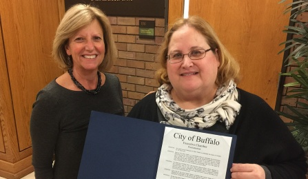 Gayle Murphy '86 (VLP) and Vice Dean for Social Justice Initiatives Melinda Saran showing off a proclamation signed by Buffalo Mayor Brown recognizing organizations who provide pro bono legal services.