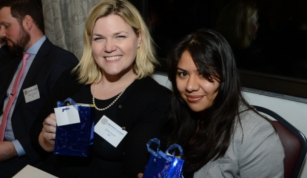 Anne E. Joynt '05 and her mentee Rosa Guerrero '18 showing off the prizes they'd won at a Mentor Kickoff Reception